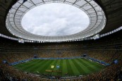 A general view of the stadium is seen as the national anthems are sung before the start of the 2014 World Cup third-place playoff between Brazil and the Netherlands at the Brasilia national stadium in Brasilia in this July 12, 2014 file photo. REUTERS/Ruben Sprich/Files