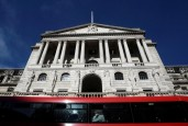 People travel on a bus as it passes the Bank of England in the City of London, in London, Britain September 28, 2016. REUTERS/Toby Melville/File Photo