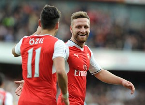 LONDON, ENGLAND - OCTOBER 15: (L) Mesut Ozil celebrates scorin the 3rd Arsenal goal ieht (R) Shkodran Mustafi  during the Premier League match between Arsenal and Swansea City at Emirates Stadium on October 15, 2016 in London, England. (Photo by Stuart MacFarlane/Arsenal FC via Getty Images)