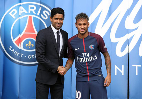Neymar is unveiled alongside Paris Saint Germain president Nasser Al-Khelaifi during a press conference at the Parc des Princes, following his world record breaking £200million transfer from FC Barcelona to Paris Saint Germain. PRESS ASSOCIATION Photo. Picture date: Friday August 4, 2017. Photo credit should read: Jonathan Brady/PA Wire. RESTRICTIONS: EDITORIAL USE ONLY