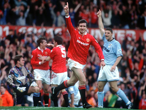 23 APR 1994:  A PICTURE SHOWING ERIC CANTONA OF MANCHESTER UNITED FOOTBALL CLUB AS HE RUNS OFF WITH HIS ARM RAISED IN CELEBRATION AFTER SCORING THE FIRST GOAL IN HIS FIRST GAME AFTER HIS SUSPENSION AGAINST MANCESTER CITY IN THEIR PREMIER LEAGUE MATCH Mandatory Credit: Anton Want/ALLSPORT