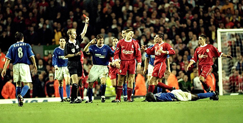 27 Sep 1999:  Steven Gerrard of Liverpool is shown the red card after his foul on Everton's Kevin Campbell (floor) during the FA Premier League match between Liverpool and Everton played at Anfiled, Liverpool, England. The Merseyside derby finished in a1-0 win for visitors Everton.  Mandatory Credit: Michael Steele /Allsport
