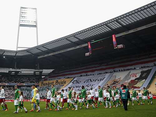 BREMEN, GERMANY - MARCH 01: The teams enter the pitch prior to the Bundesliga match between Werder Bremen and Hamburger SV at Weserstadion on March 1, 2014 in Bremen, Germany.  (Photo by Joern Pollex/Bongarts/Getty Images)